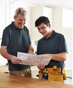 Electrician viewing blueprints - Delaware Apprenticeship program